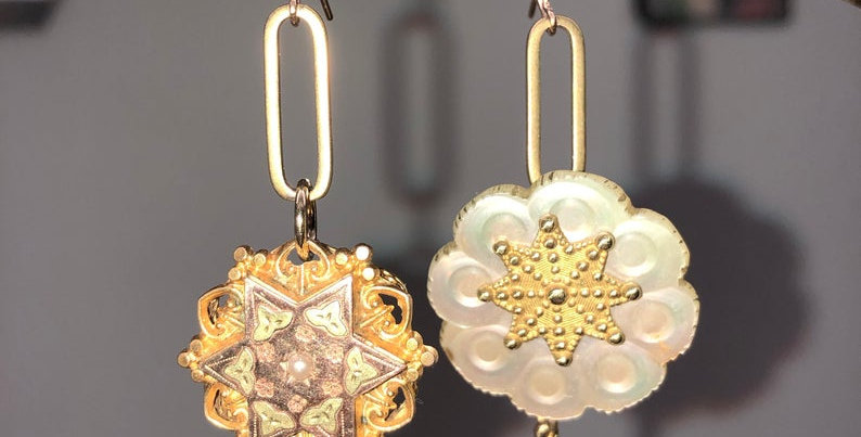 Mismatched vintage star earrings created from Victorian elements