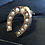 Thumbnail: Victorian 9ct horse shoe stud with split pearls