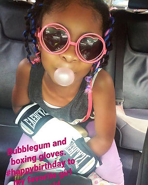 Bubblegum and boxing gloves. Our baby gi