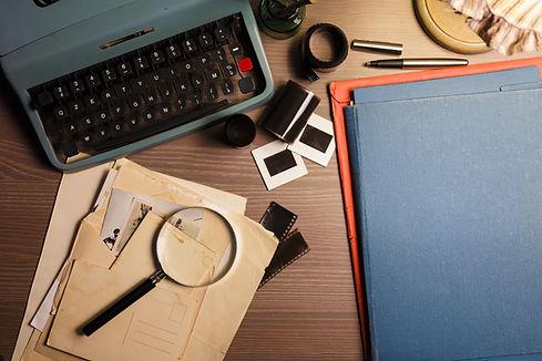 Investigator desk with confidential docu