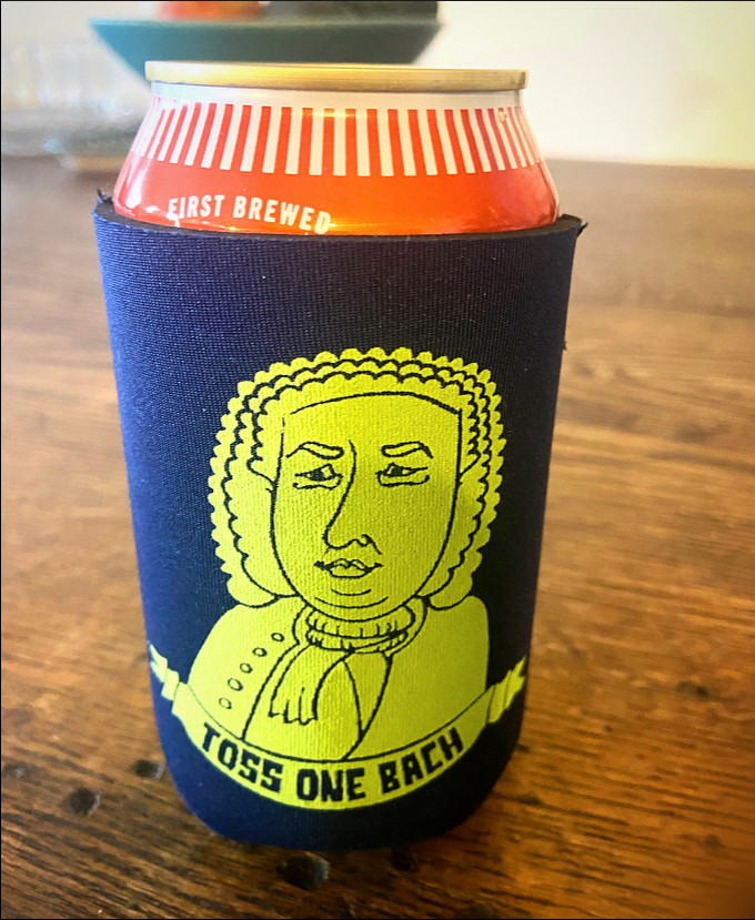 Toss One Bach beer koozie