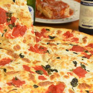 Margarita Pizza made with fresh mozzarella, plum tomatoes and basil
