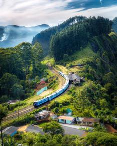 photo-of-railway-on-mountain-near-houses