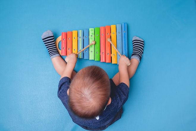 1 year old baby boy child hold sticks &