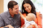 Hispanic-couple-at-home-with-baby-700px.