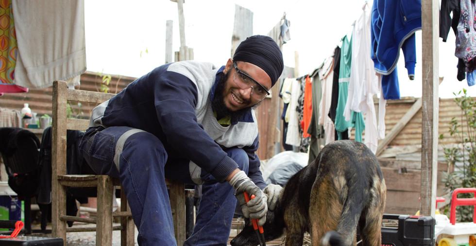 Reo tying with dog - Gurseerat Khalsa.jp
