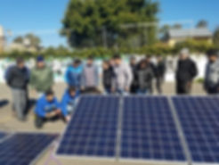 Teaching a solar panel installation course.