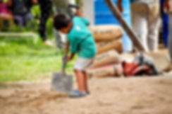 Child digging near the construction site