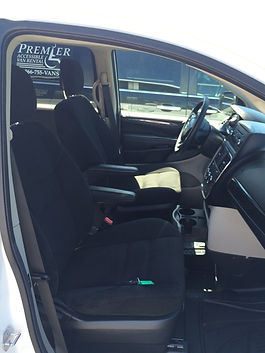 View of driver's seat and front passenger seat in a side entry wheelchair accessible van