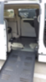 Side entry wheelchair accessible van with ramp deployed with view of tracks/straps to secure the wheelchair