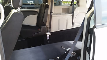 View of the area where the wheelchair is secured in a rear entry handicap accessible van