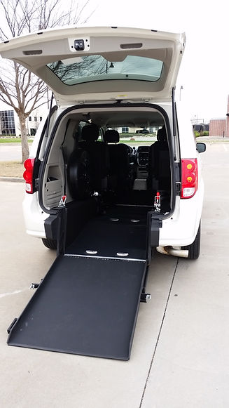 View of the ramp deployed in a rear entry handicap accessible van