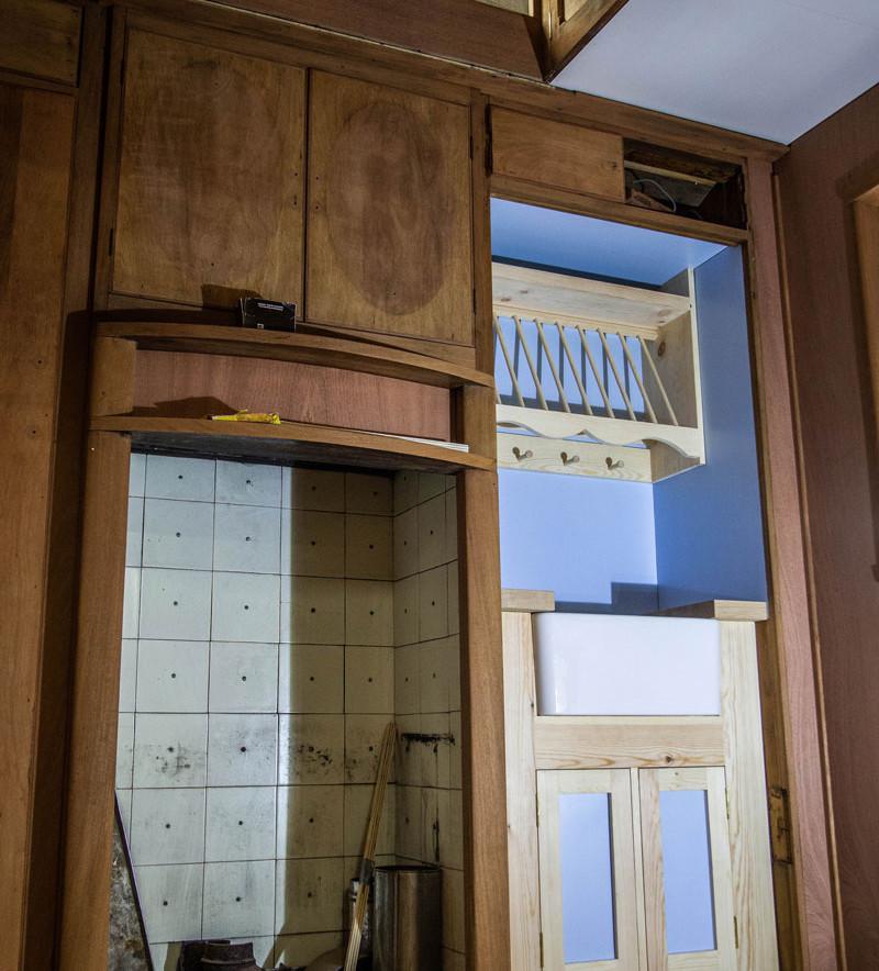 a secret kitchen area behind a door
