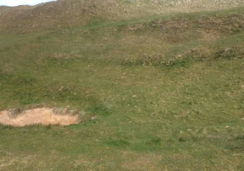 Pit in sixth fairway