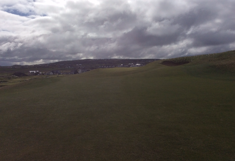 Ninth fairway to sloping green
