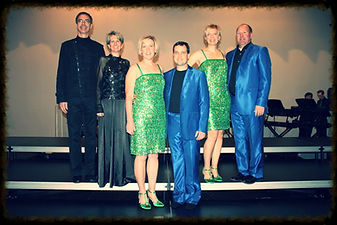 Photo of show choir parents in costume on stage