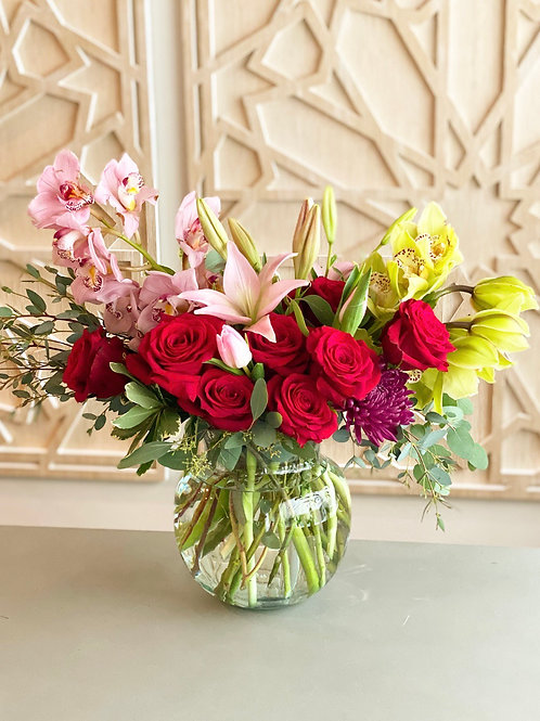Premium Roses and Cymbidium orchids with pops of lilies and tulips