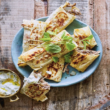 """Musakhan Wraps // Flatbread with Shredded Chicken, Onion and Sumac from """"Sumac"""" by Anas Atassi."""