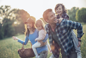 Happy family who has found a mortgage to get them into their first home.