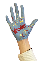 Grey painted hand with red and yellow paint squiggles and the word WONDER in bright red