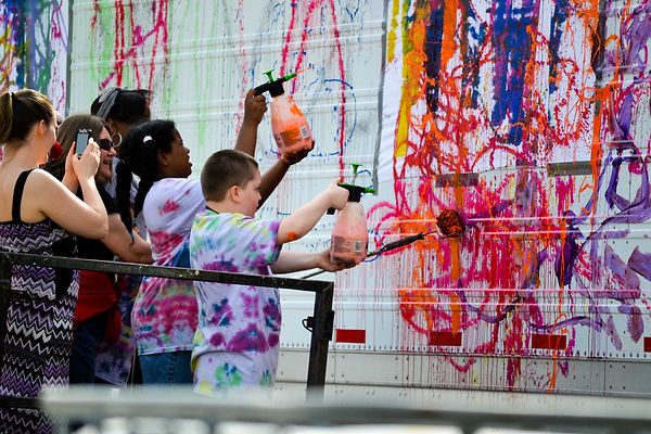 ACT students use paint sprayers to create fun artwork