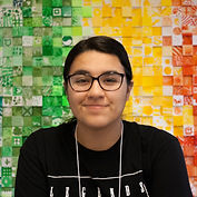 Jasmine Rodriguez-Zuniga headshot in front of colorful green, yellow, and red background