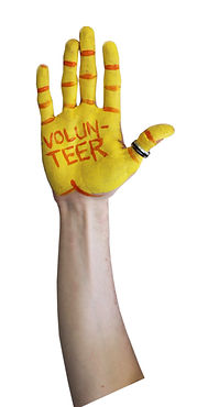 Yellow and orange painted hand that reads VOLUNTEER in orange paint