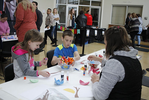 ACT students make some cool crafts at a community event
