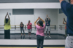 ACT Teaching Artist leads students in an adult body movement class