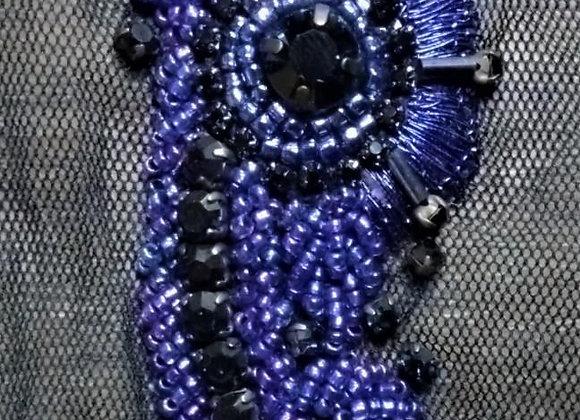 Close-up of dark navy trim with black stones