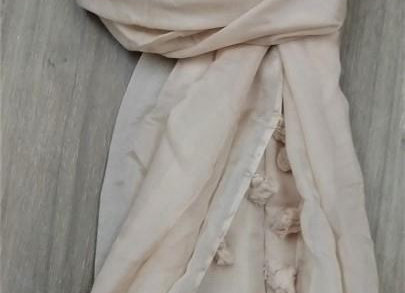 Look of classic beige scarf with beige tassels