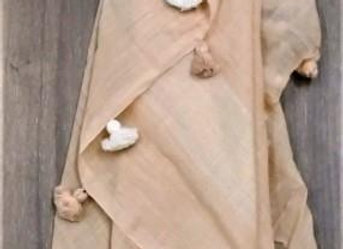 Look of classic peach scarf with tassels