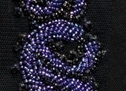 Dark Navy hand-beaded trim in looping patterns