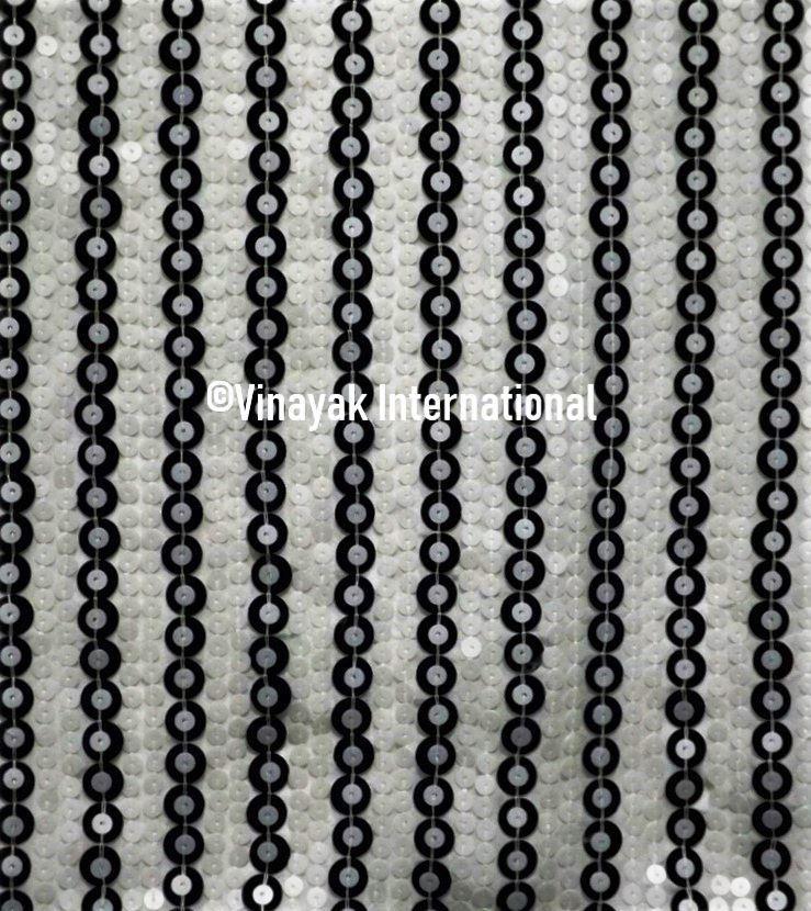 Alternating black and white sequin novelty