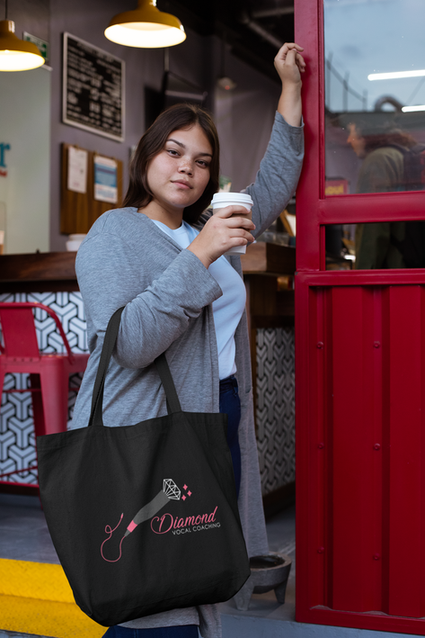 sublimated-tote-bag-mockup-of-a-woman-having-a-coffee-to-go-30970.png
