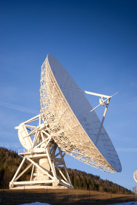 Satellite broadcasting dish with blue sk