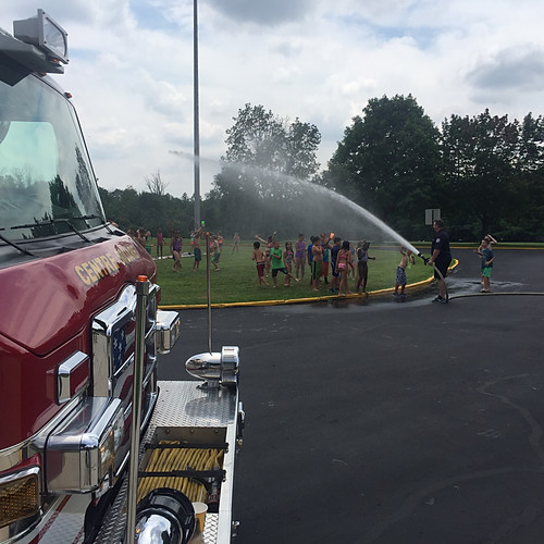 Firefighters hosing down campers at Whitpain's Stony Creek Day Camp