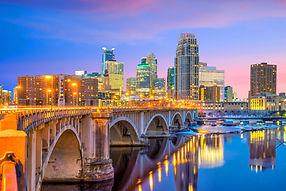 Minneapolis downtown skyline in Minnesota, USA at sunset.jpg