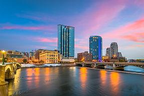 Grand Rapids, Michigan, USA downtown skyline on the Grand River at dusk..jpg
