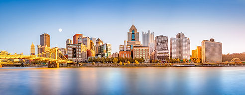 Long exposure of Pittsburgh downtown skyline and Roberto Clemente bridge, on a sunny after