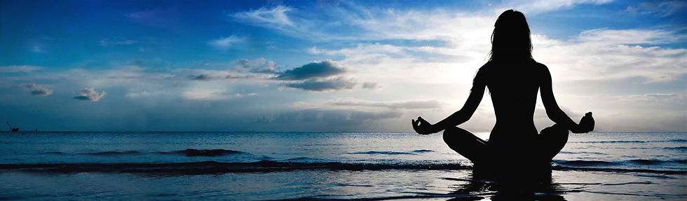 yoga-sea-beach-woman-doing-breath-retent