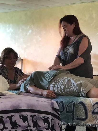 Tammy Stephens and Sondra Lambert doing Reiki
