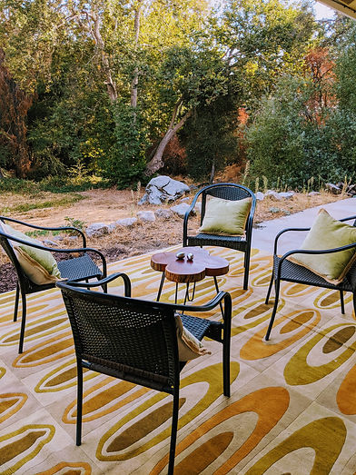 CHS-outdoor patio with yellow rug.jpg