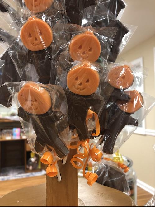 Pumpkin-headed scarecrow pop