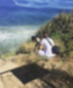 Taking pictures off a cliff in point Dume, Malibu, California