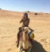 Riding a camel on a desert safari in Dubai, UAE