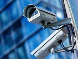 Camêras e vigilância em fundo azul