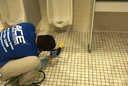 Restroom cleaning services with a Commerical cleaning restroom extraction machine.