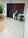 Commercial Cleaning Services With Backpack Vacuum in an Office Lobby