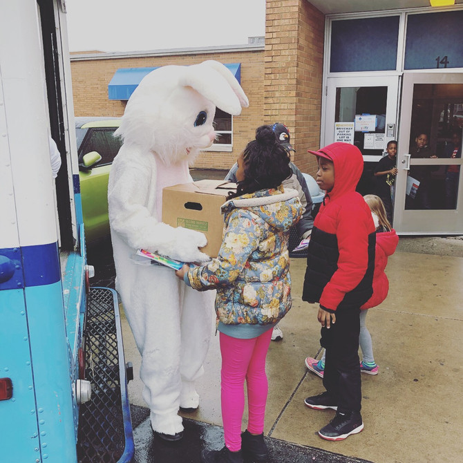 Easter Bunny helps hand food boxes!